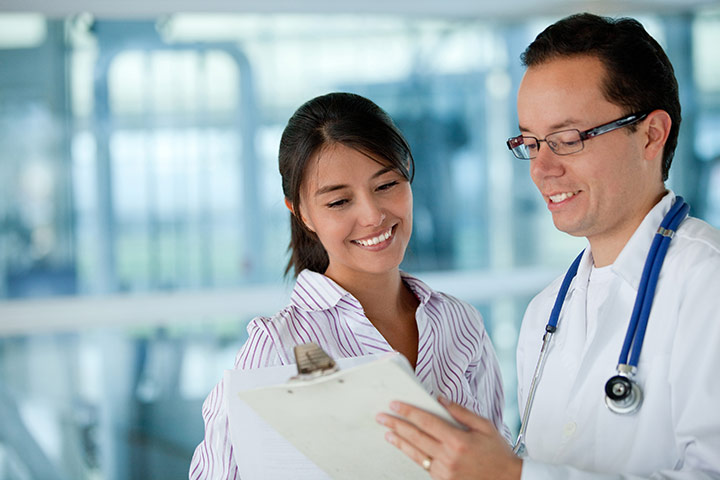 image of a medical professional reviewing a document